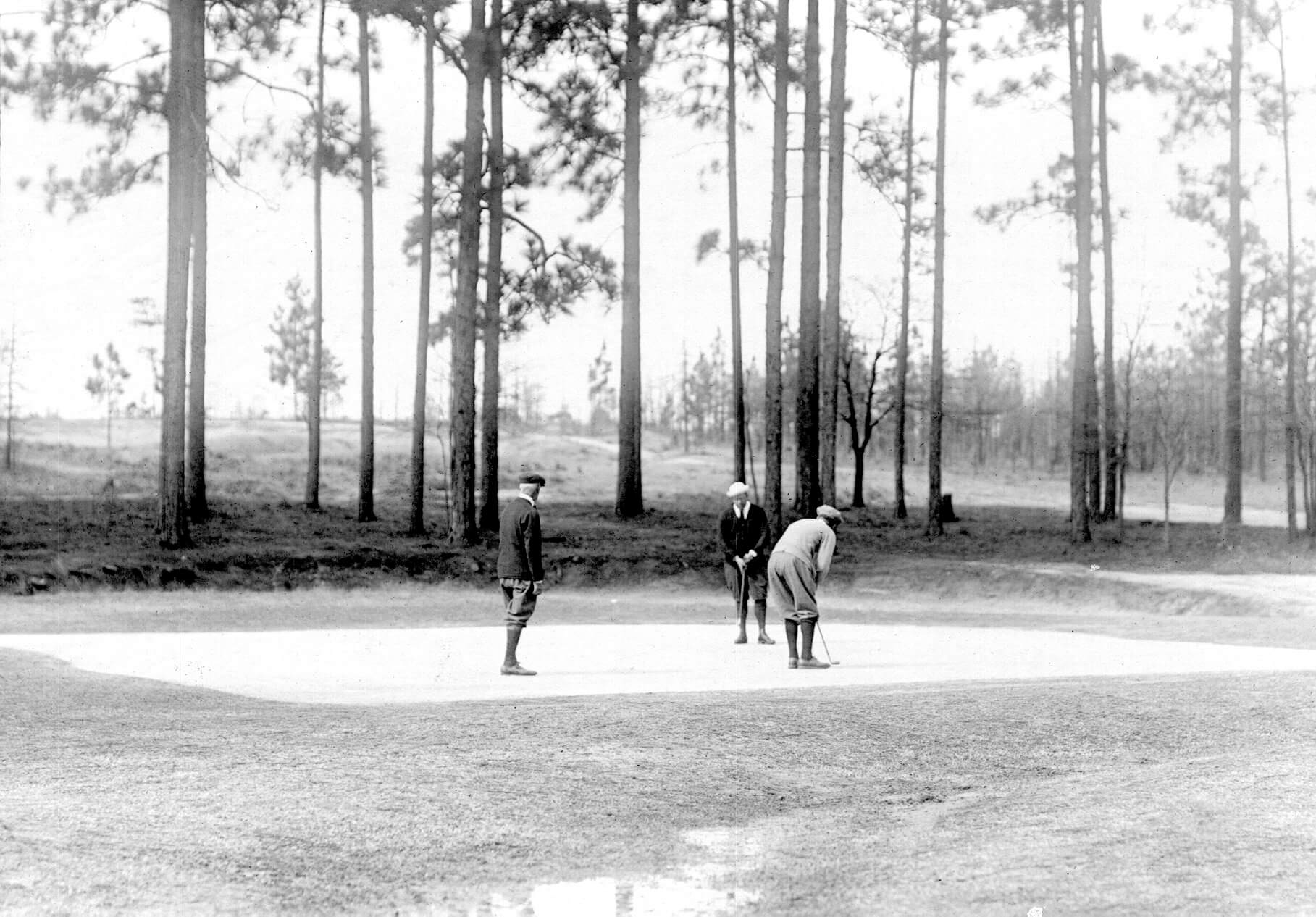 Before Donald Ross refined grass-growing techniques, Pinehurst's fabled greens were covered with a combination of sand and mud. Photo courtesy of the Tufts Archives