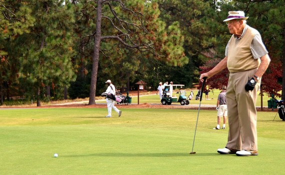 M.O. Owens, at 100 years old, lines up a putt on Pinehurst No. 2.
