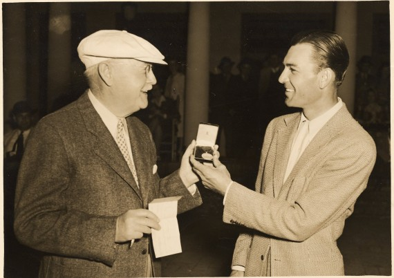 Donald Ross presents Ben Hogan with a medal after one of Hogan's three victories in the prestigious North & South Open.