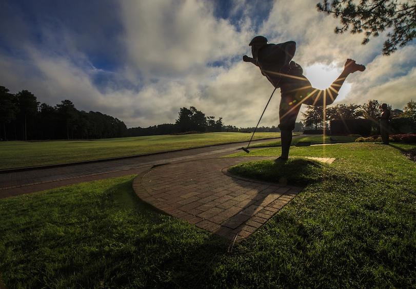 Payne Stewart statue at dusk