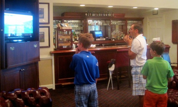 Andres Schonbaum, an Argentinian golfer, watches his native country compete in the World Cup on a television at the Pinehurst No. 8 clubhouse during the 114th North & South Amateur.