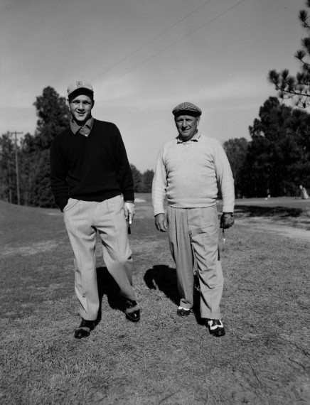 Arnold Palmer and his father Deacon, on the 9th hole of Pinehurst No. 2 in 1954. Photo Courtesy of the Tufts Archives