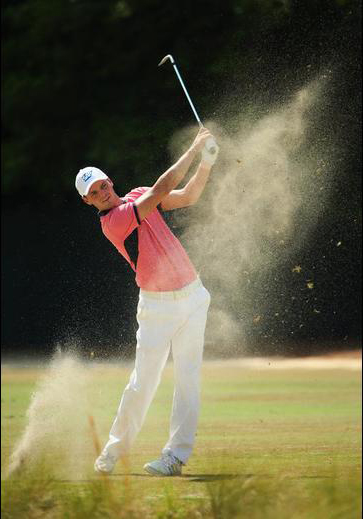 Martin Kaymer of Germany hits his second shot on the third hole during the third round. (Andrew Redington/Getty Images)