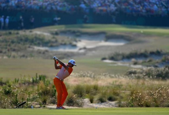 Rickie Fowler hits his tee shot on the 13th hole during the final round.  (Ross Kinnaird/Getty Images)