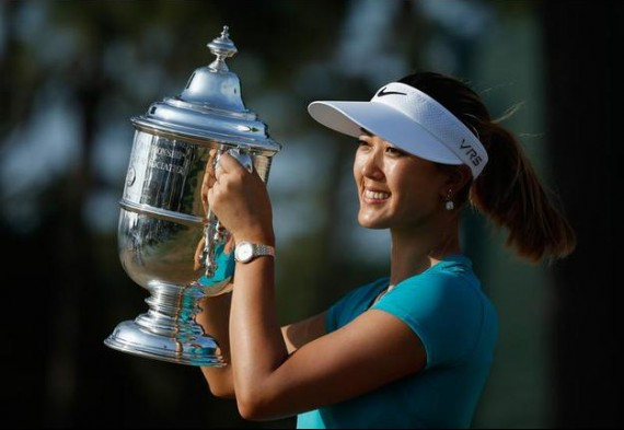 Michelle Wie poses with the trophy after her two-stroke victory at the 69th U.S. Women's Open. (Scott Halleran/Getty Images)