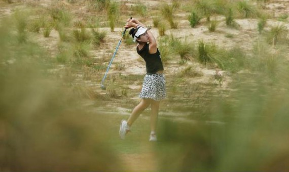Eleven year-old amateur Lucy Li hits her second shot on the eighth hole during the second round. (Scott Halleran/Getty Images)