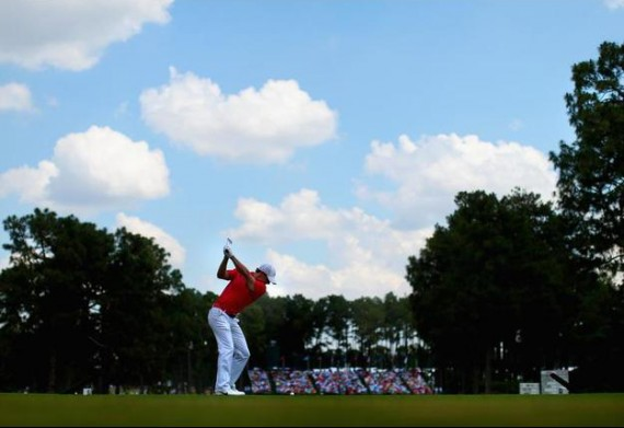 Rory McIlroy hits his tee shot on the 17th hole during the second round. (Mike Ehrmann/Getty Images)