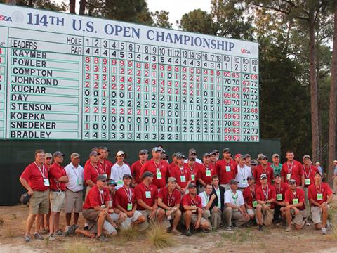 The Pinehurst Grounds Crew poses for a photo below the Sunday scoreboard following Martin Kaymer's triumph in the 2014 U.S. Open on Pinehurst No. 2.