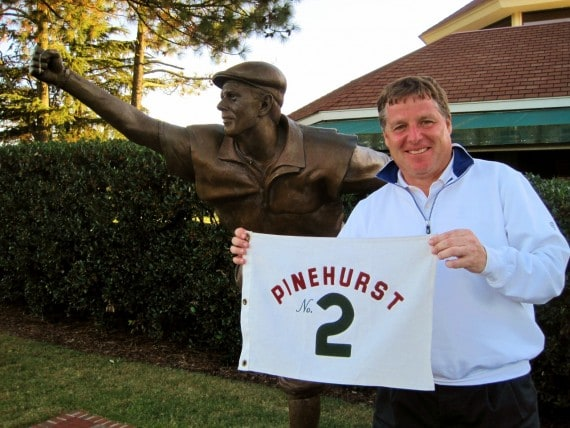 Don Potter stands with the flag from the 18th green on Pinehurst No. 2 after making eagle.